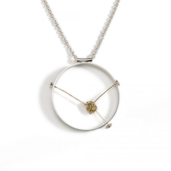 Statement pendant with circular silver frame and a knot of 18ct gold wire in the centre unraveling into three wires which form neat loops on the outside of the frame