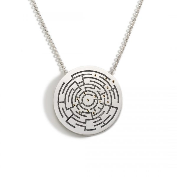 Circular silver statement pendant with an etched and oxidised maze and 18ct gold dots showing the way out
